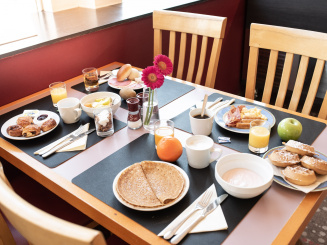 Delicious breakfast on table in Bruges Green Park Hotel Brugge.jpg