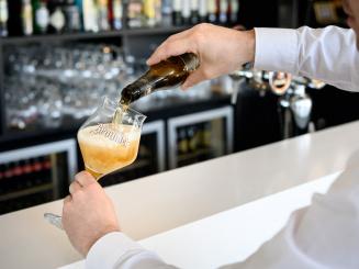 Barman pouring a beer in the Leopold Hotel Oudenaarde.jpg