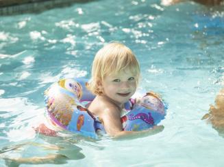 Girl swimming in pool in Green Park Hotel Brugge.jpg